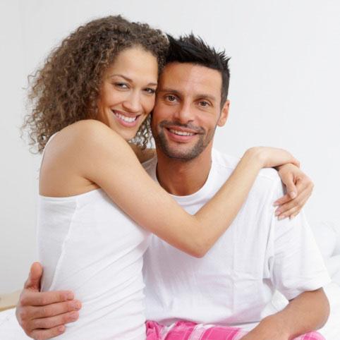 Portrait of happy romantic young couple
